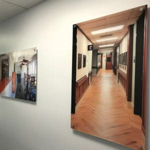 Stud mounted acrylic photos on wall of Dockside Logistics
