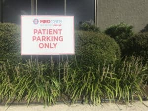 Patient Parking only yard sign in bushes