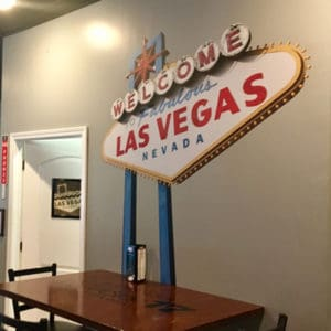 Custom cut wall graphic in shape of Welcome to Las Vegas sign